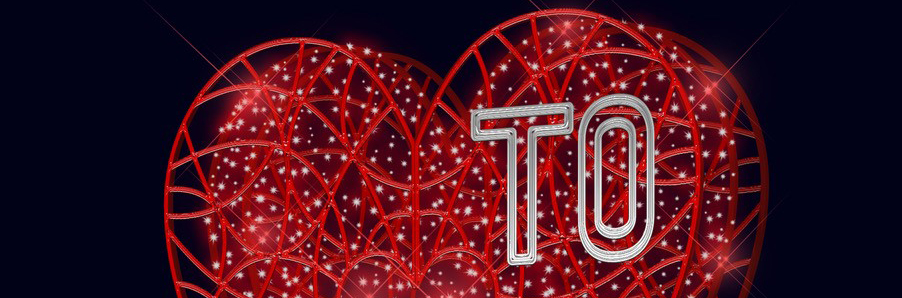 Upper half of a neon red three-dimensional heart with the letters T and O superimposed on it.