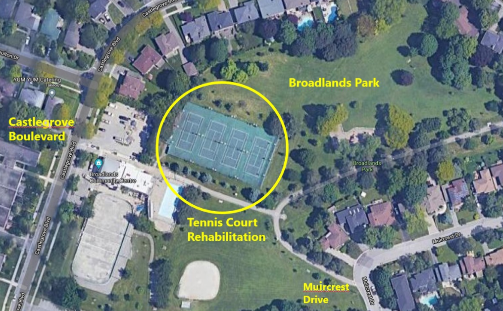 An aerial overview of the location of the four tennis courts in Broadlands Park, circled in yellow. The tennis courts are located parallel to Castlegrove Boulevard, beside the parking lot.