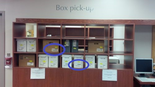 Archives box pick-up area with box number labels highlighted.